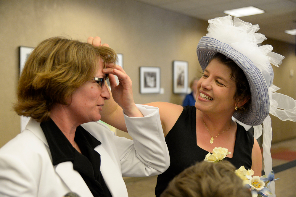 . Fran Simon (L) gets her hair fixed by Anna Simon as they  arrive at the Denver County clerk\'s office where they began issuing same sex marriage licenses July 10, 2014. (Photo by John Leyba/The Denver Post)