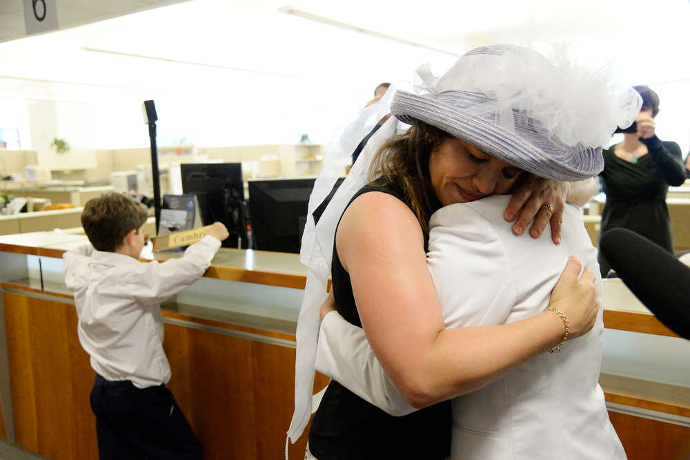 . Anna Simon (L) hugs Fran Simon after it was official, the first same sex married couple to get their license at the Denver County clerk\'s office where they began issuing same sex marriage licenses July 10, 2014. (Photo by John Leyba/The Denver Post)