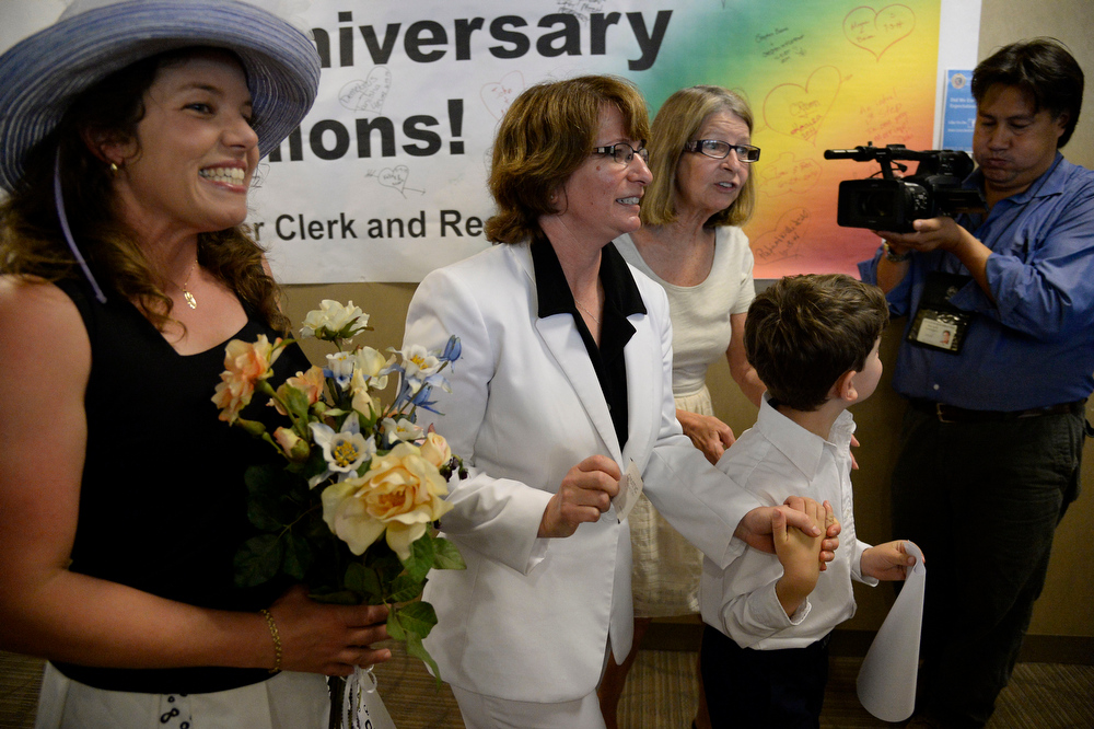 . Anna Simon (L) and Fran Simon and Jeremy Simon head back to get their license at the Denver County clerk\'s office where they began issuing same sex marriage licenses July 10, 2014. (Photo by John Leyba/The Denver Post)