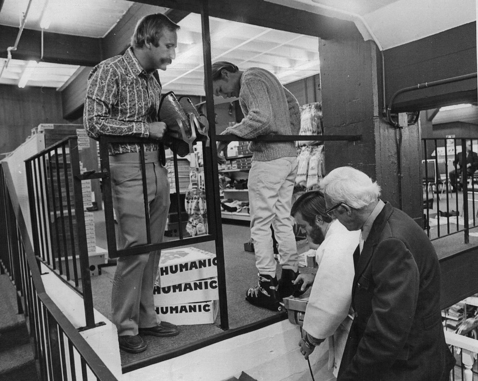 . John Marsing shows Stan Cebula, of Gart Bros., right, how Customizer system works as Herb Hyna has boot  fitted properly in 1971. The Denver Post