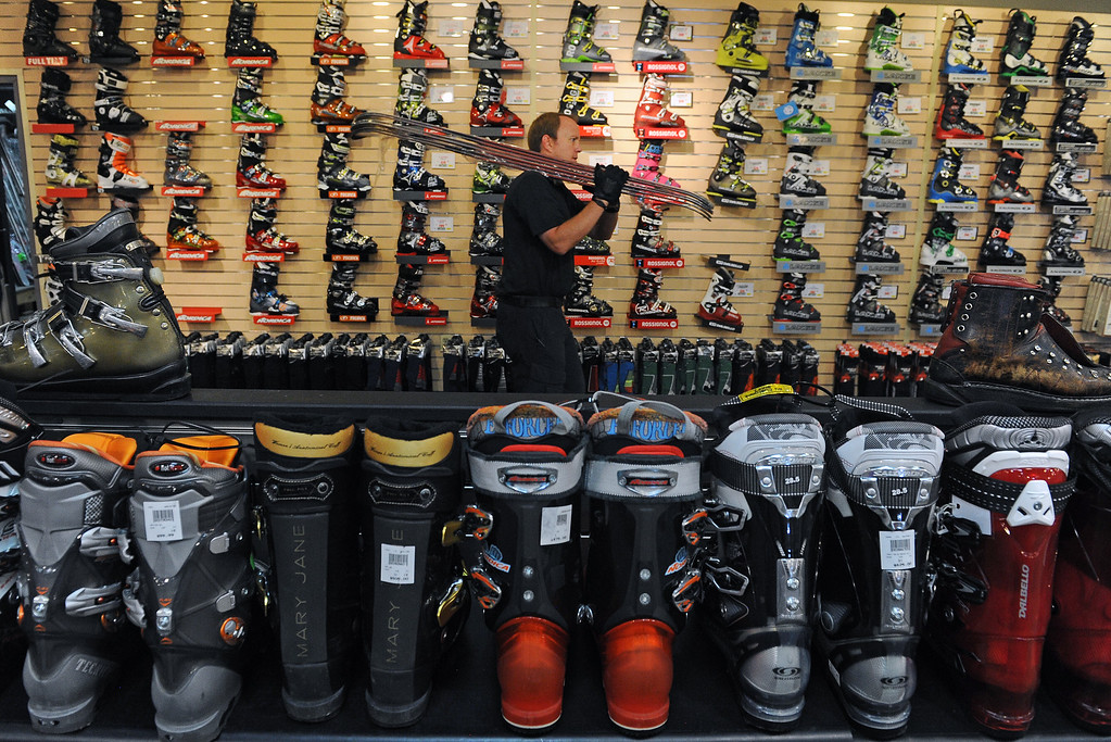 . AURORA, CO - AUGUST 28:  Bradley Paris, an alpine salesman, carries skis out to place on shelves  at Colorado Ski & Golf at  2650 South Havana street in Aurora, CO on August 28, 2013 in preparation for the company\'s  huge upcoming Labor Day weekend Ski Rex sales event.  Ski retailers have rising expectations that an improving economy  will push sales this fall.  There are three big sales this weekend in the metro area:   Ski Rex, Sniagrab and Powder Daze.  Photo by Helen H. Richardson/The Denver Post