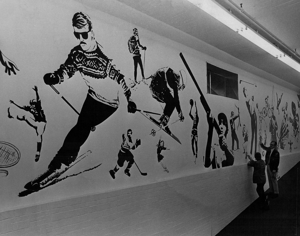 . Gart Bros. Artists Discuss their 20-By-60-Foot Mural in 1971. Jim Judd and Al Ayres worked for three weeks painting the mural that depicts virtually all popular sports.