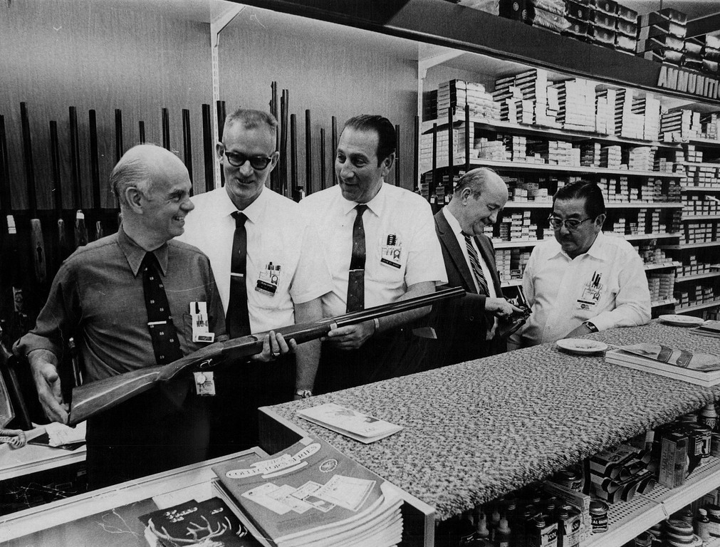 . In keeping with Gart Bros, long-standing policy, every man in the gun department on the Broadway level of the new store is a competent hunter and marksman. Staff members, from left, are Lou Hill; Rich Cunningham; Mike Di Sanza, manager of the department. Bill Thornton and Dick Kimura. Kimura is a specialist in shotgun reloading. The staff is trained and eager to help a customer make the right selection. 1971 The Denver Post