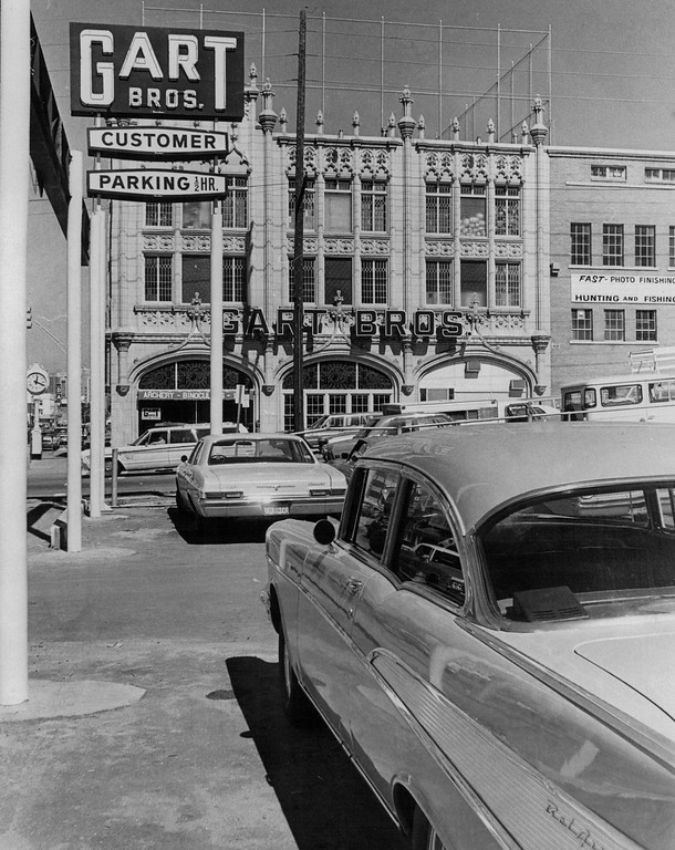 . Customers at Gart Bros. new 10th Ave. and Broadway store will find ample free parking in 1971. Jerry Gart said additional parking will be available when the adjacent tire shop is demolished. Drive - through photo finishing and sporting goods shopping windows also are planned.