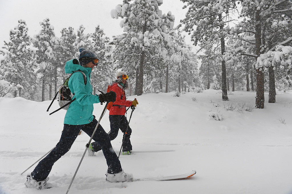 . Kestrel Hanson Neathawk, left in blue, and Sara Born, in red,  get first tracks along Ridge Road as they enjoy the almost 2 feet of snow on April 16, 2016 in Nederland, Colorado. A spring storm dumped more than 2 feet of snow in the foothills and more is expected overnight.  (Photo by Helen H. Richardson/The Denver Post)