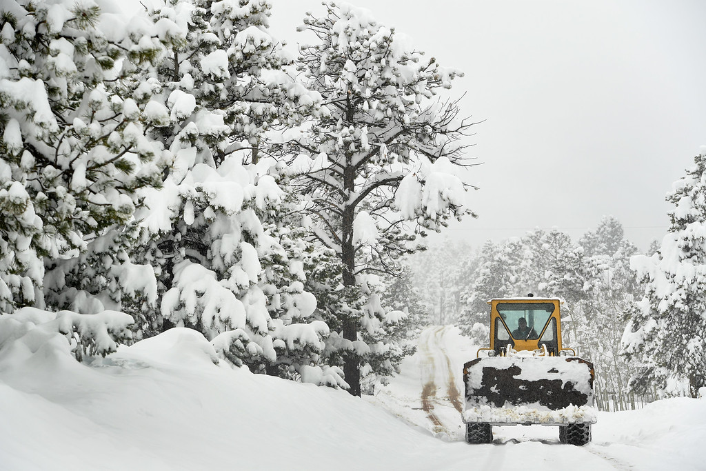 . NEDERLAND, CO - APRIL 17: A large front loader makes it\'s way up Ridge Road to clear snow on April 17, 2016 in Nederland, Colorado. A slow moving spring storm dumped almost 3 feet of snow in the foothills.  (Photo by Helen H. Richardson/The Denver Post)