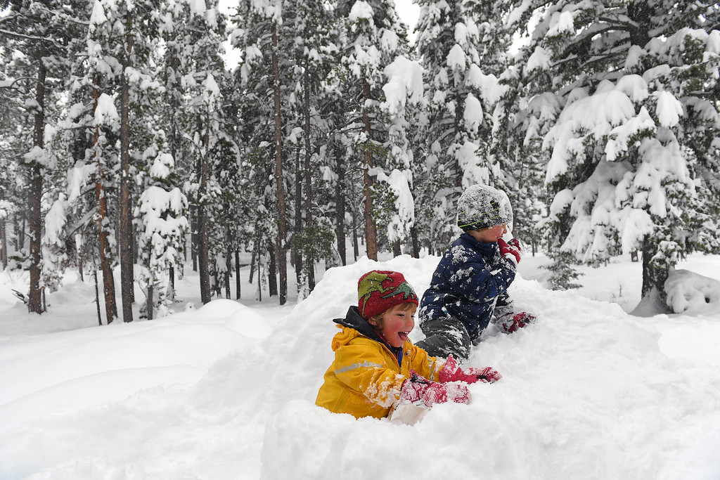 . NEDERLAND, CO - APRIL 17: Wyatt Dodge, in back, 4, and his brother Nixon, 3, play in the snow in their driveway on April 17, 2016 in Nederland, Colorado. A slow moving spring storm dumped almost 3 feet of snow in the foothills. Over 35 inches of snow fell in the area over a two day period. (Photo by Helen H. Richardson/The Denver Post)