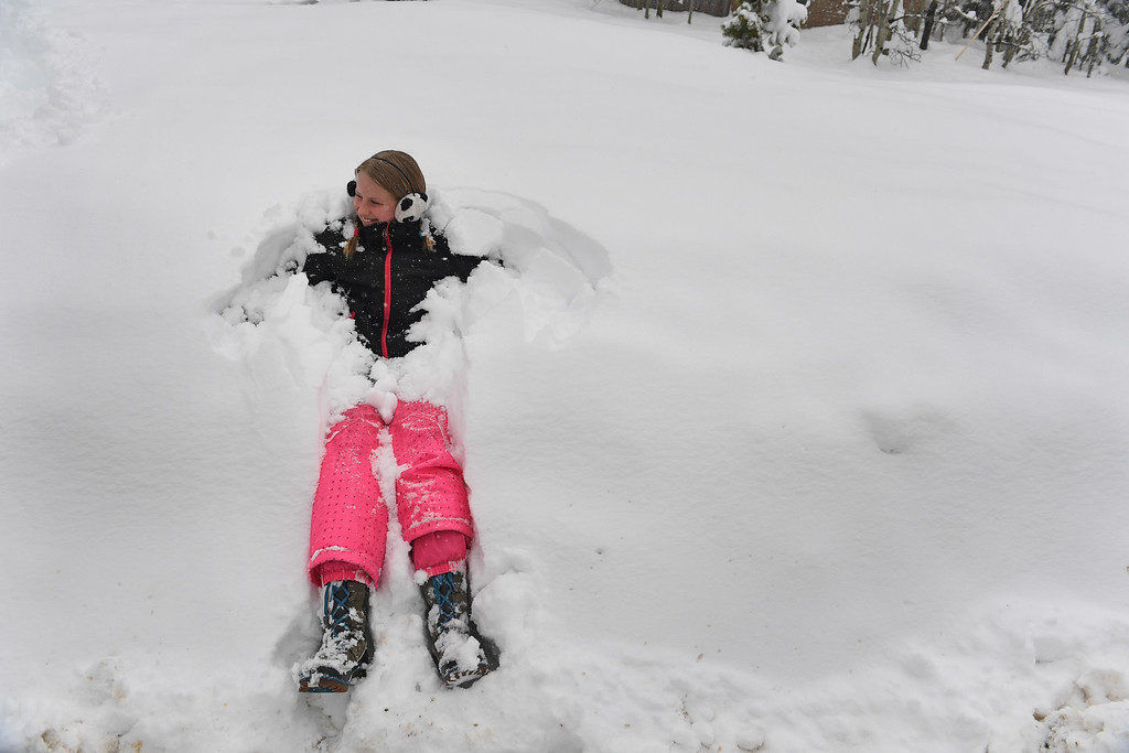 . NEDERLAND, CO - APRIL 17: Meg Feeley plays in the snow in her driveway on April 17, 2016 in Nederland, Colorado. A slow moving spring storm dumped almost 3 feet of snow in the foothills. Over 35 inches of snow fell in the area over a two day period. (Photo by Helen H. Richardson/The Denver Post)