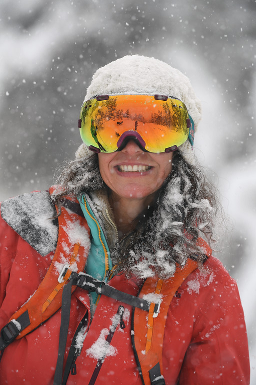 . Sara Born, is covered in falling snow as she skis along Ridge Road on April 16, 2016 in Nederland, Colorado. A spring storm dumped more than 2 feet of snow in the foothills and more is expected overnight.  (Photo by Helen H. Richardson/The Denver Post)