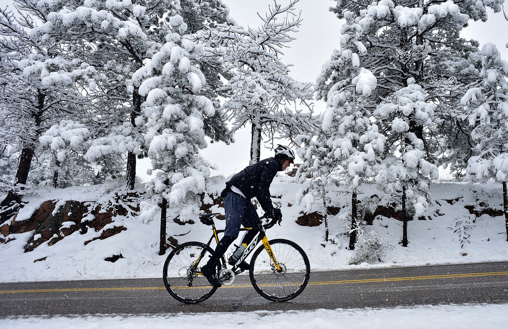 . Boulder resident John Winsor rides his bike up Flagstaff Road in Boulder, Colorado, Saturday, April 16, 2016. Heavy wet snow is expected to continue falling through the end of the weekend in Denver and Boulder, according to the National Weather Service.  (Brenden Neville/Special to the Denver Post)