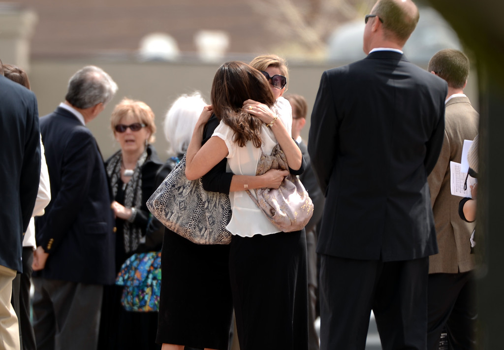 . People comfort each other in front of Most Precious Blood Catholic Church. Kristine Kirk, allegedly killed by her husband while she called 911, is memorialized at funeral mass in Denver, Colorado,  April 25, 2014. (Photo by Hyoung Chang/The Denver Post)