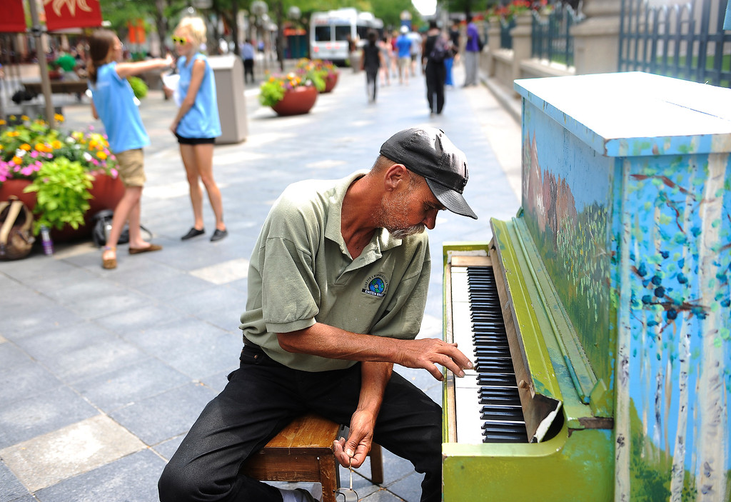 . Visit with the many piano players that  play the pianos that are along 16th Street Mall in downtown Denver on Tuesday, July 19, 2011.   Bud Chappell a  trumpet player,  plays one handed at Arapahoe and 16th Street. Cyrus McCrimmon, The Denver Post