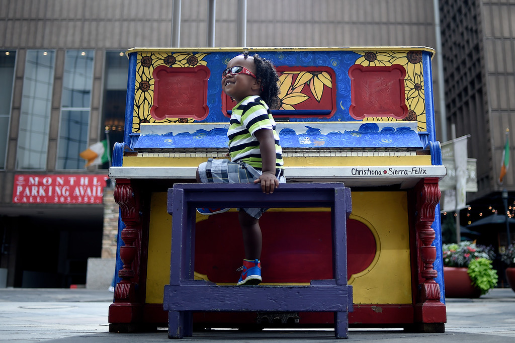 . Okenyon Scott, 2, plays the piano on 16th Street Mall on Tuesday, September 22, 2015. (Photo by AAron Ontiveroz/The Denver Post)