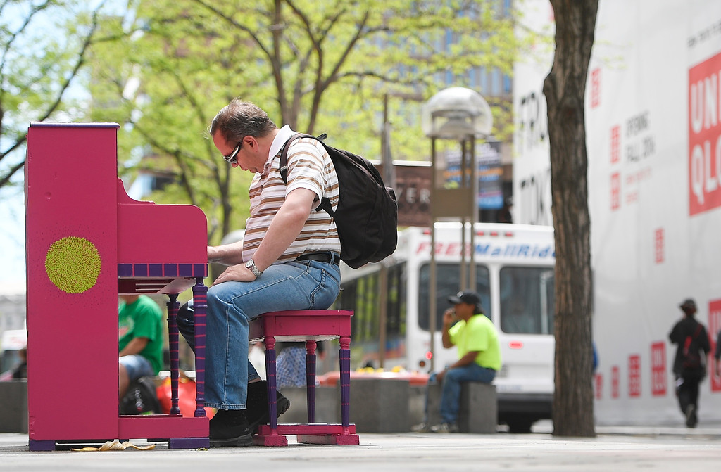 ". The pianos are back! The pianos are back! The ""Your Keys to the City\"", public art program pianos along the 16th Street Mall  have come out from winter hibernation in downtown Denver on Monday, May 09, 2016.  Noel Mitchell plays \""Amazing Grace\"" on a piano on near Tremont Place on the mall. (Photo by Cyrus McCrimmon/The Denver Post)"