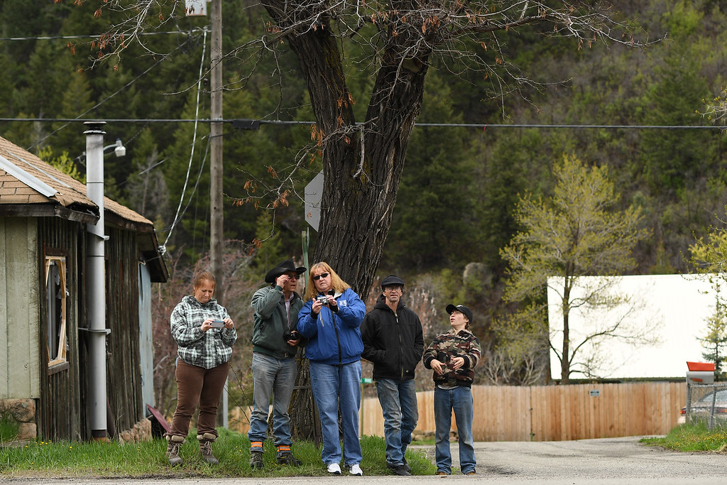 . Residents look at their photos after crews demolished a concrete coal silo as part of environmental reclamation work at the Oxbow Mine in Somerset, Colorado, April 29, 2016. The silo was used for loading coal onto trains.  (Photo by RJ Sangosti/The Denver Post)