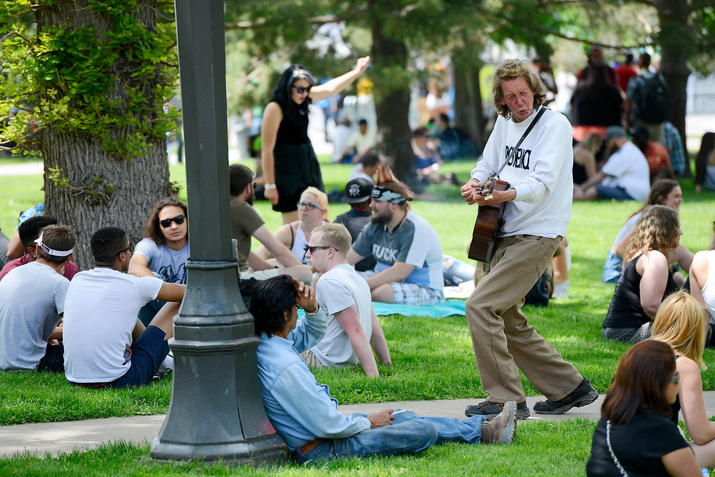 . Carl Howard serenades festival goers during the Denver 420 Rally held Saturday at Civic Center Park. (Photo by Kira Horvath/ The Denver Post)