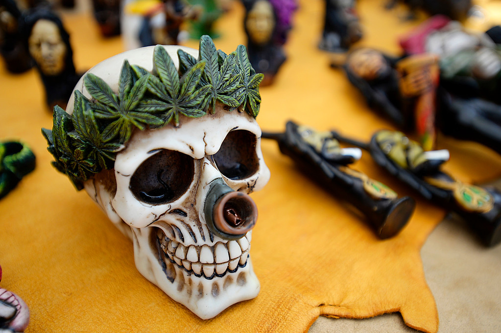 . A skull shaped pipe at The Incas merchandise table at the Denver 420 Rally held Saturday at Civic Center Park. (Photo by Kira Horvath/ The Denver Post)