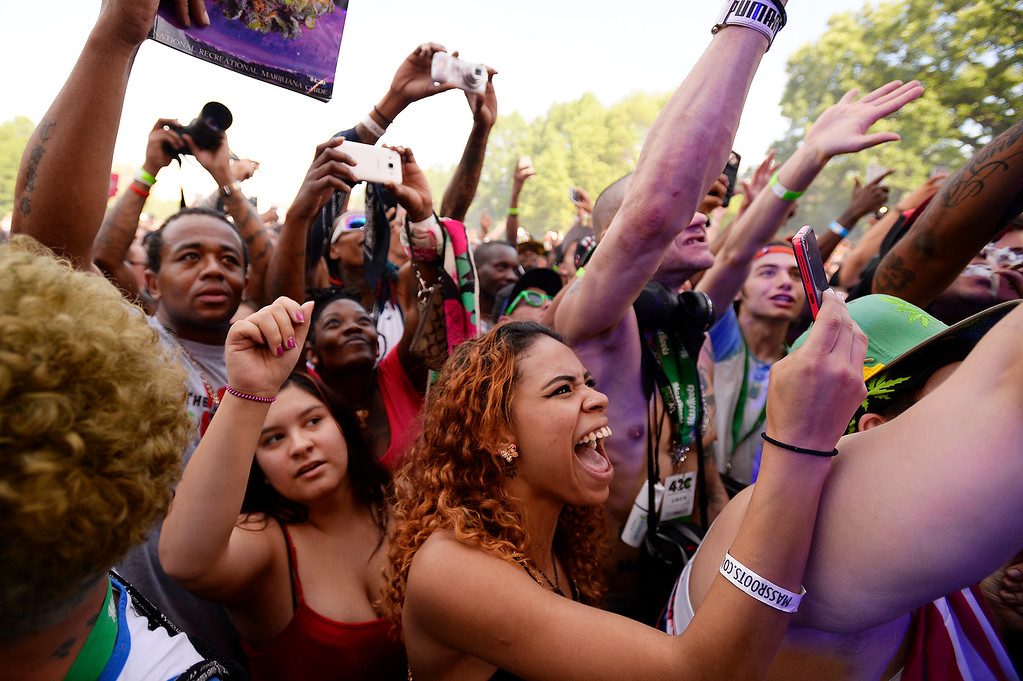 . Fans cheer for Wiz Khalifa as he performs during the Denver 420 Rally held Saturday at Civic Center Park. (Photo by Kira Horvath/ The Denver Post)