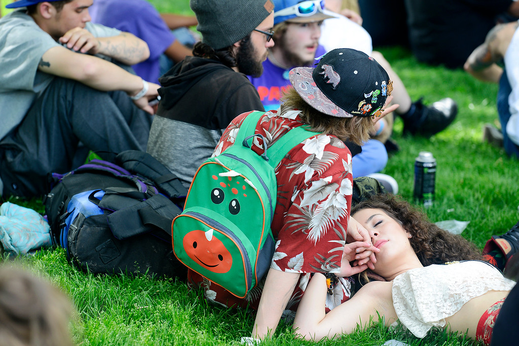 . Camryn Molina and Desiray Vincioni find a shady spot to enjoy the music during the Denver 420 Rally held Saturday at Civic Center Park. (Photo by Kira Horvath/ The Denver Post)