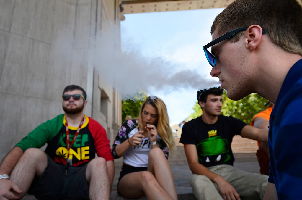 . From left, Michael Hertweck, Mariah Elliott, Charlie Freimiller and Kenneth Burress drove 16 hours from Indiana to partake in the Denver 420 Rally held Saturday at Civic Center Park. (Photo by Kira Horvath/ The Denver Post)