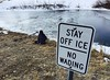 A sign is shown at the banks of a pond Friday morning. Legend High School photography student Taylor Walker visited the site Friday morning, January 15, 2016. (Photo by Kenneth D. Lyons/The Denver Post)