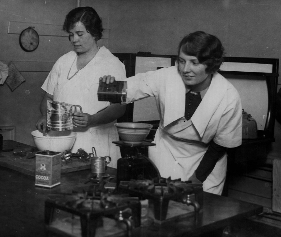 . Come On Boys they do turn out good cooks at Denver\'s Emily Griffith Opportunity School. Cooking class 1930s. Denver Post Library photo archive