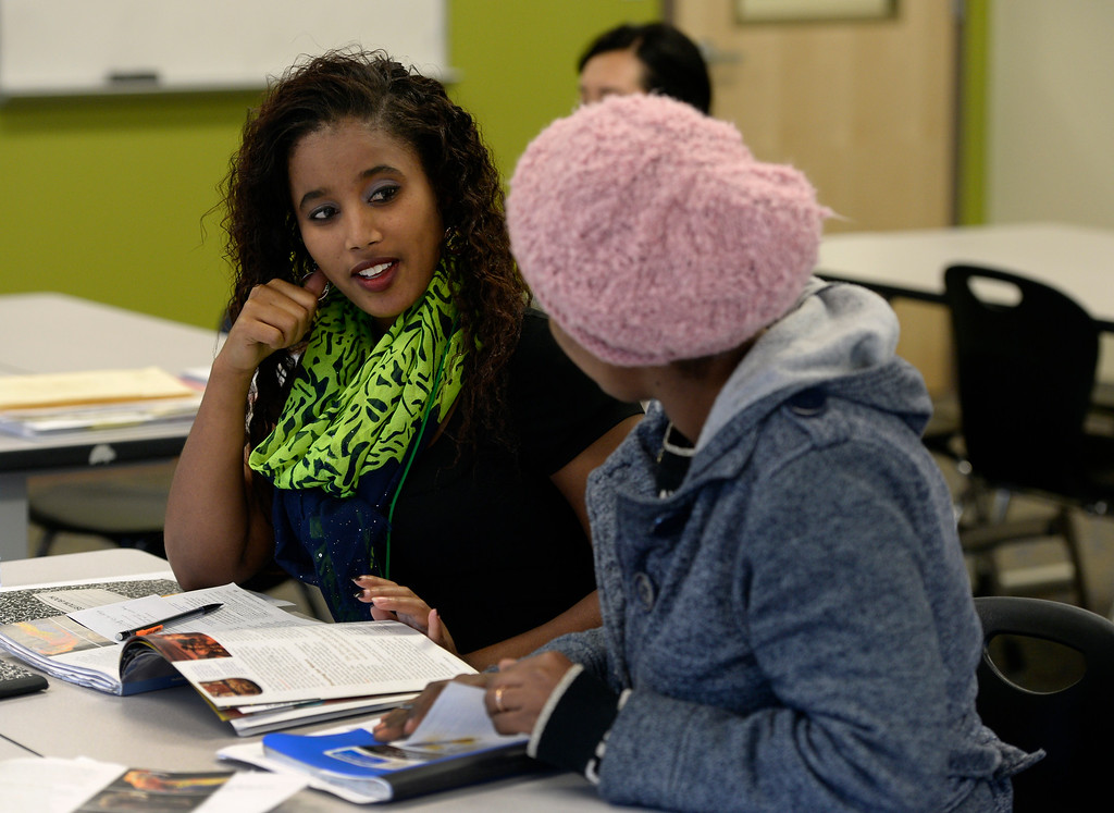 """. Duniya Yusuf works on adjectives and verbs with fellow students in her Vocational Transitions class. The Emily Griffith Technical College will be marking its 100th year in service on Sept. 9, 2016, and is presenting a year-long community celebration, \""""Opening Doors of Opportunity for 100 Years\"""". The school boasts a student population from 94 countries speaking 72 different languages and offers more than 50 different certification programs, from accounting to Welding.  (Photo by Kathryn Scott Osler/The Denver Post)"""