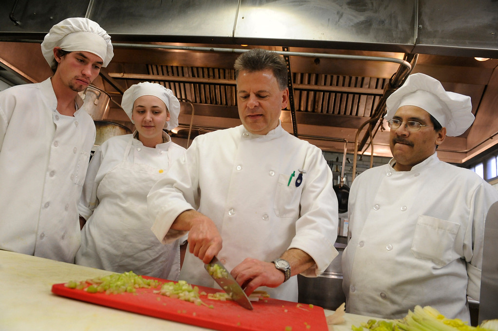 . Chef Tim Inzano teaches Culinary Arts Department students at the Emily Griffith Opportunity School in Denver.   Students, from left, David Wasinki, Chrissy French-Mack, and Max Gutierrez watched the beginnings of a salad Tuesday afternoon, December 9, 2008 during class.   Denver Post photo by Karl Gehring