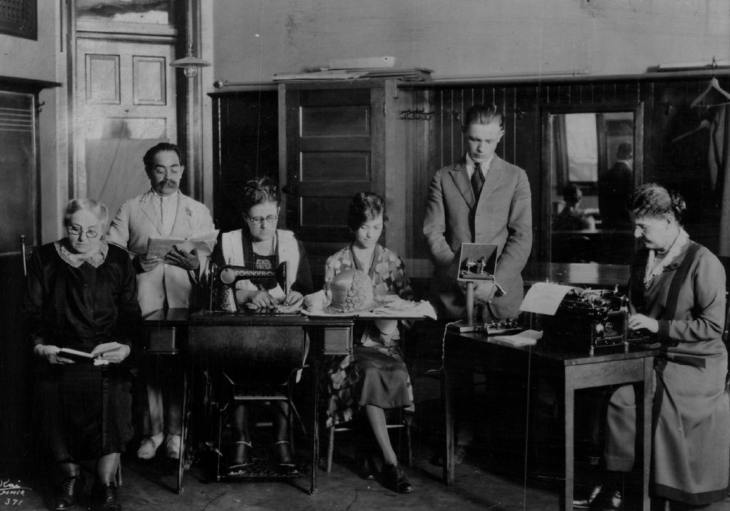 . Old photo, circa 1916, showing school\'s 1st classes: l to r high school subjects, English for foreign born, sewing, industrial millinery, telegraphy, typewriting.  Emily Griffith Opportunity School in Denver Denver Post Library photo archive