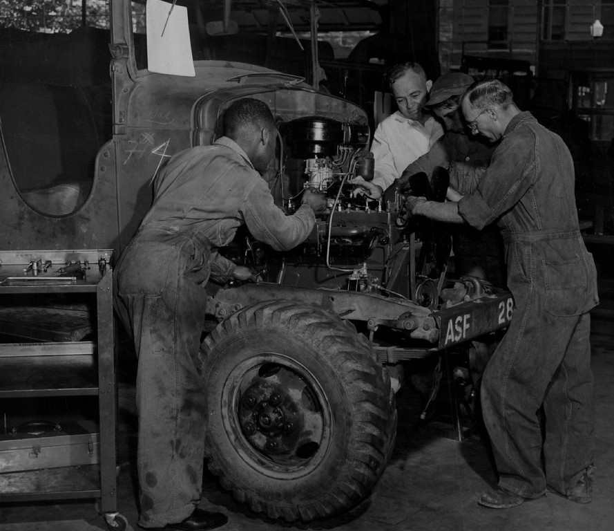 . Emily Griffith Opportunity School mechanics L to R Webb Jackson, Albert Krutzer, Victor La Terra, Fred Hill in 1944. Denver Post Library photo archive