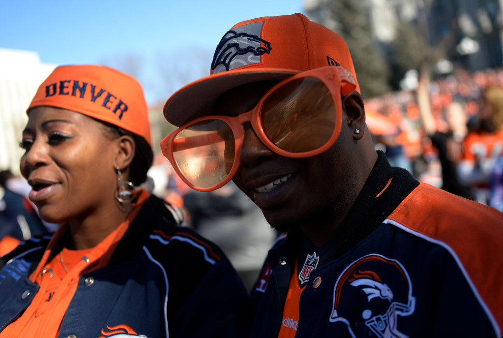. The Denver Broncos were celebrating their Super Bowl victory with a parade through the streets of Denver on Tuesday, February 09, 2016. Broncos fans Patrice Toliver, left, and husband Travon Toliver listen to the rally near the capitol.  (Photo by Cyrus McCrimmon/ The Denver Post)