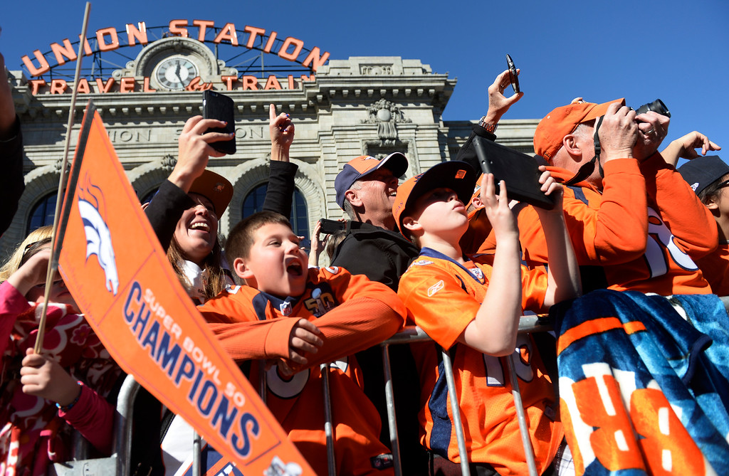 . The Denver Broncos were celebrating their Super Bowl victory with a parade through the streets of Denver on Tuesday, February 09, 2016. At Union Station fans holler as the team drives by.  (Photo by Cyrus McCrimmon/ The Denver Post)