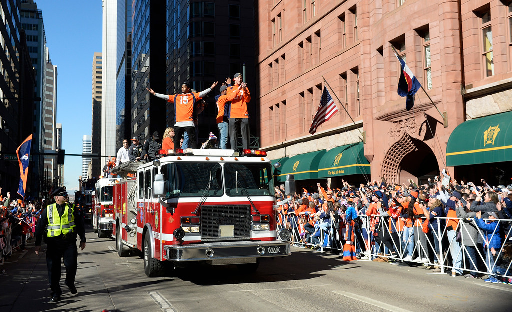 . The Denver Broncos were celebrating their Super Bowl victory with a parade through the streets of Denver on Tuesday, February 09, 2016. Along 17th Street Bronco players Kyle Williams, left#15, and  Jordan Taylor, right, celebrate from on top a emergency vehicle.    (Photo by Cyrus McCrimmon/ The Denver Post)