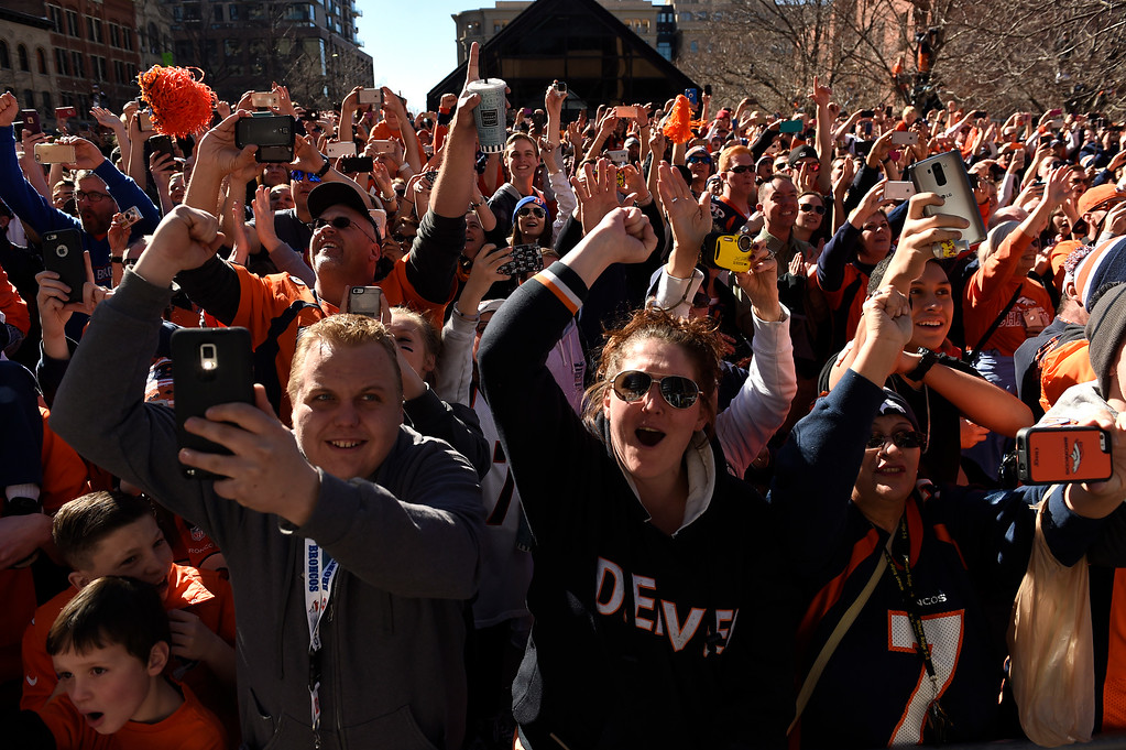 . Broncos fans cheer as the Denver Broncos players riding on Denver Fire Department engines and fire trucks pass them along 17th Street during the Denver Broncos Super Bowl 50 victory parade and rally on February 9, 2016 in Denver, Colorado.   (Photo by Helen H. Richardson/The Denver Post)
