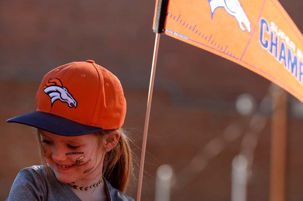 . DENVER, CO - JANUARY 9:  Marin Helwick, 6, of Brighton, sits on her father Jon\'s shoulders as they wait along 17th street to watch the Denver Broncos Super Bowl 50 victory parade on February 9, 2016 in Denver, Colorado.   (Photo by Helen H. Richardson/The Denver Post)