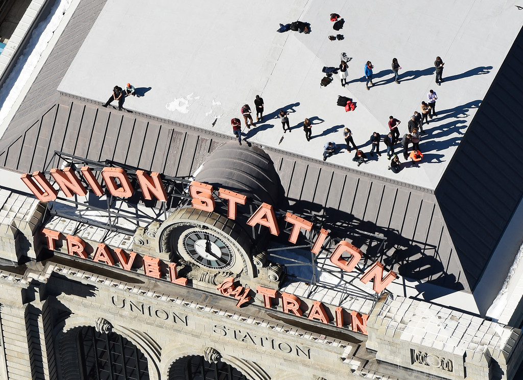 . Fans gather on top of Union Station, in downtown Denver, during a parade to celebrate the Denver Broncos winning Super Bowl 50, February 09, 2016. The parade when from Union Station and ended at Civic Center Park. (Photo by RJ Sangosti/The Denver Post)