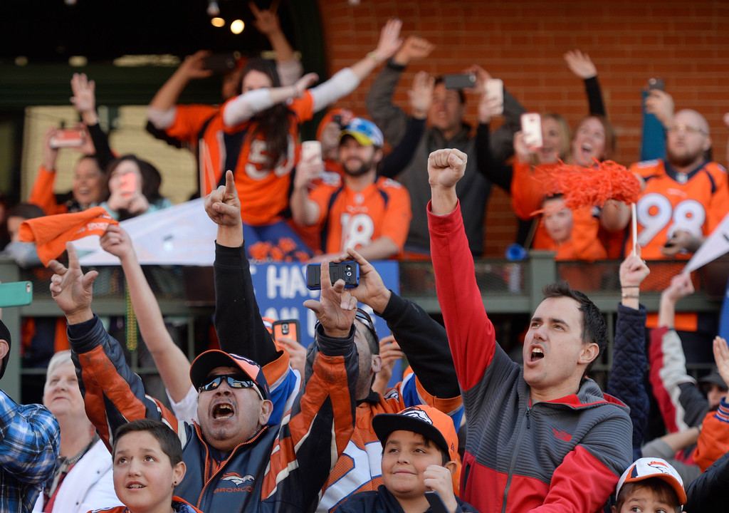 . The Denver Broncos were celebrating their Super Bowl victory with a parade through the streets of Denver on Tuesday, February 09, 2016. At Wynkoop Brewery fans cheer as the players drove by.  (Photo by Cyrus McCrimmon/ The Denver Post)