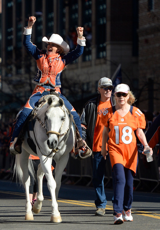 ". The Denver Broncos were celebrating their Super Bowl victory with a parade through the streets of Denver on Tuesday, February 09, 2016. At Union Station,  Ann Judge-Wegener celebrates from atop ""Thunder.\"" (Photo by Cyrus McCrimmon/ The Denver Post)"