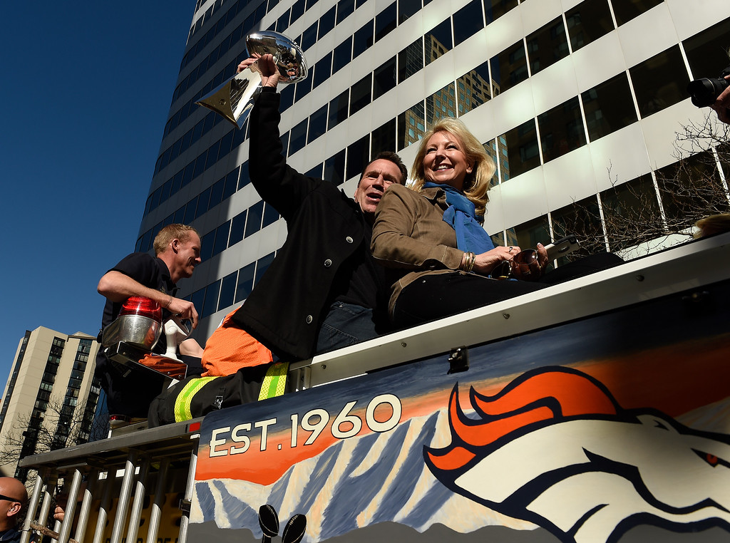 . DENVER, CO - JANUARY 9:  Denver Broncos head coach Gary Kubiak sits with his wife Rhonda while he holds the Lombardi trophy over his head as they ride atop a Denver Fire Department engine as they ride up 17th Street  during the Denver Broncos Super Bowl 50 victory parade on February 9, 2016 in Denver, Colorado.   (Photo by Helen H. Richardson/The Denver Post)