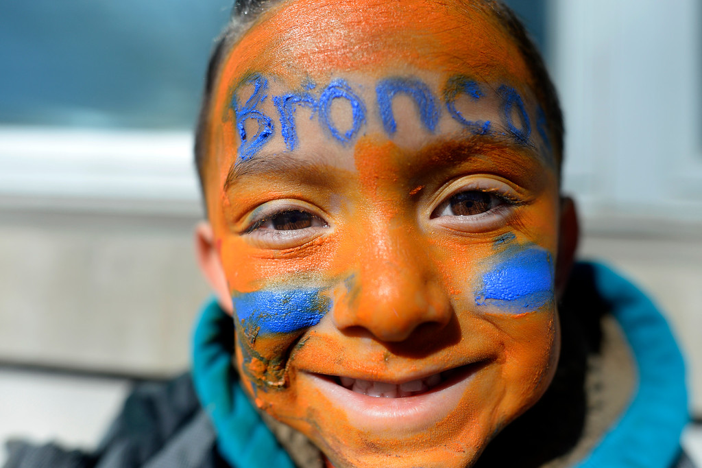 . Gabriel Cabrera wears Broncos face paint during the Denver Broncos Super Bowl championship celebration and parade on Tuesday February 9, 2016. (Photo By AAron Ontiveroz/The Denver Post)
