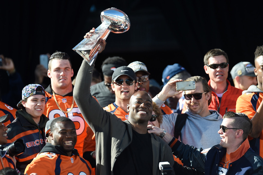 . Demarcus Ware hoists the Lombardi Trophy during the Denver Broncos Super Bowl championship celebration and parade on Tuesday February 9, 2016. (Photo By AAron Ontiveroz/The Denver Post)