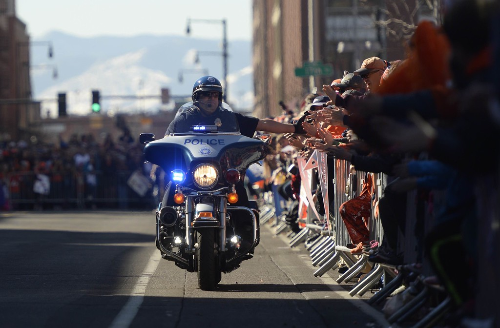 . Police high five crowd at Union station before the Broncos Super Bowl 50 Championship parade at Civic Center Tuesday morning, February 9, 2016. (Cyrus McCrimmon/The Denver Post)
