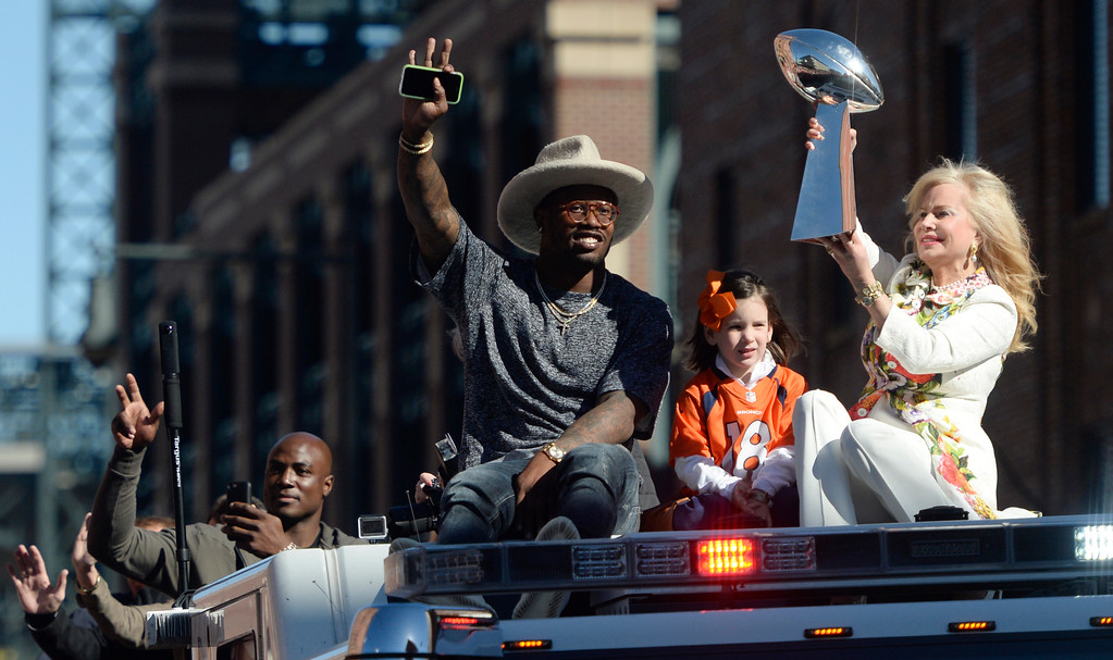 . The Denver Broncos were celebrating their Super Bowl victory with a parade through the streets of Denver on Tuesday, February 09, 2016. At Union Station Bronco player Von Miller rides with Annabel Bowen who holds the trophy.  Peyton Manning\'s daughter Mosley Manning sits in the middle.  (Photo by Cyrus McCrimmon/ The Denver Post)