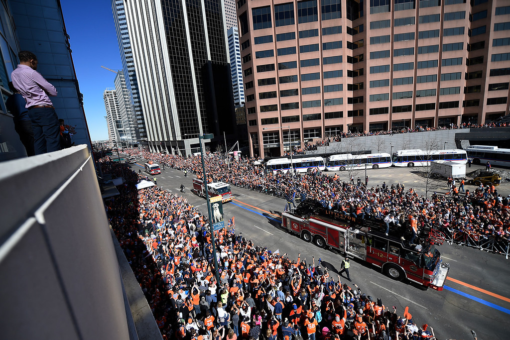 . Denver Broncos players ride in firetrucks during the Super Bowl parade down Broadway on February 9, 2016, in Denver, Colorado. (Photo by Daniel Petty/The Denver Post)