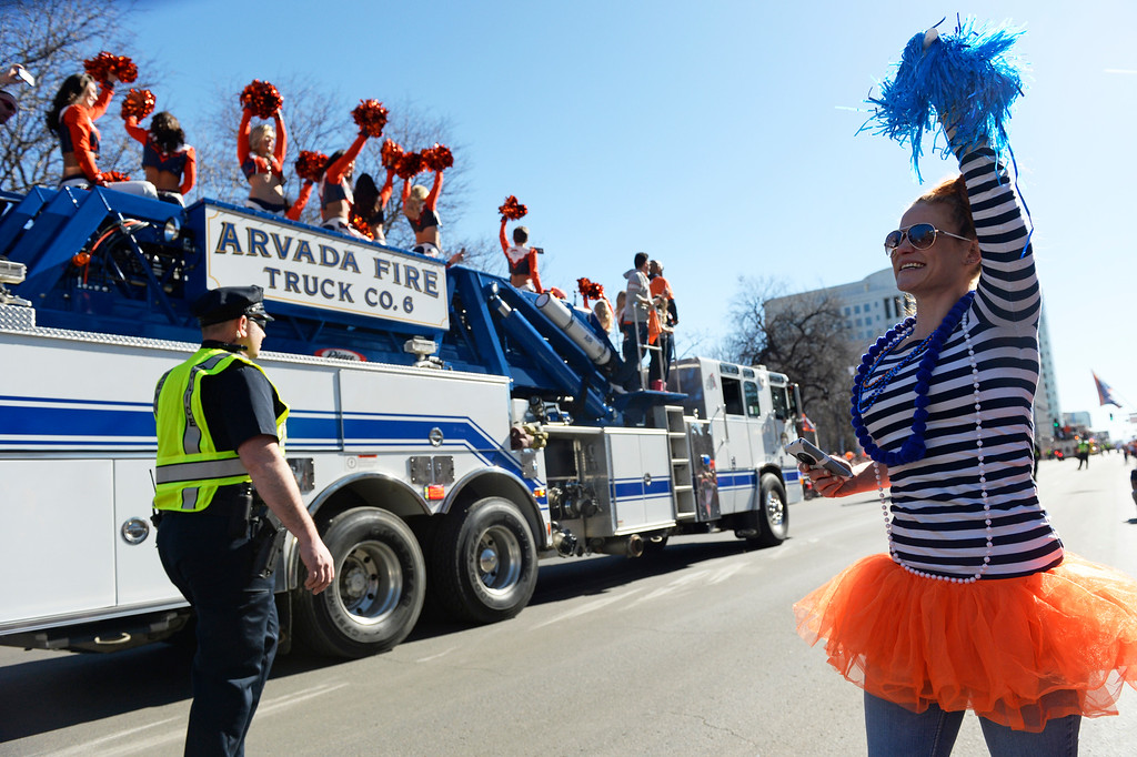 . The Denver Broncos were celebrating their Super Bowl victory with a parade through the streets of Denver on Tuesday, February 09, 2016. Molly Grout wears an orange tutu as she cheers along Broadway.  (Photo by Cyrus McCrimmon/ The Denver Post)