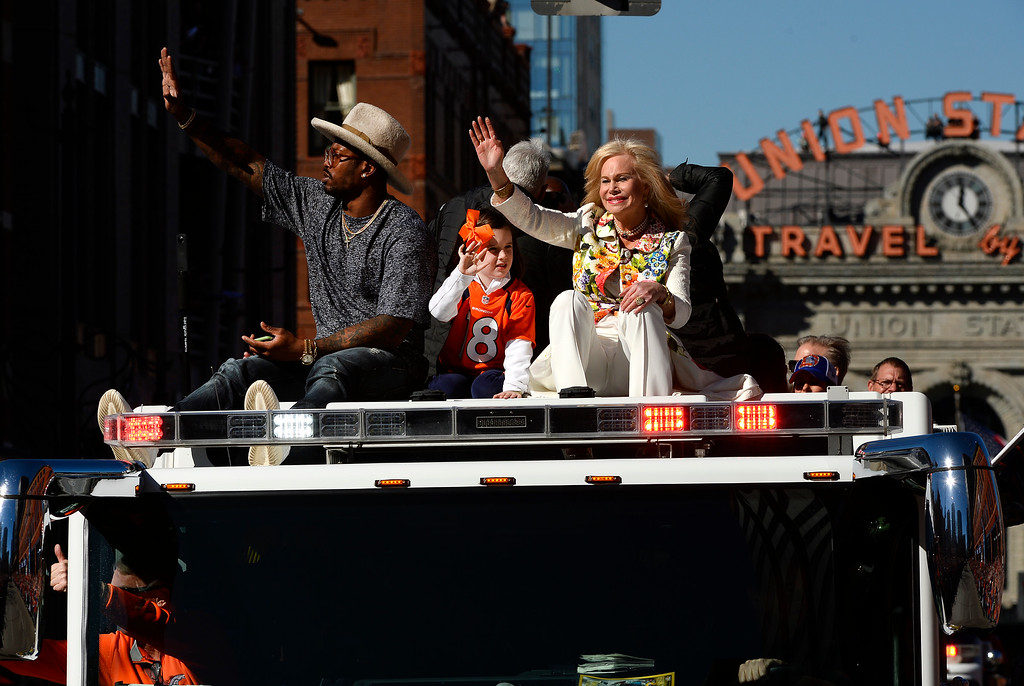 . DENVER, CO - JANUARY 9:  Super Bowl MVP and Broncos Linebacker Von Miller, left, sits atop a Denver Fire engine with Broncos owner Pat Bowlen\'s wife Annabel Bowlen, right, and Mosley Manning, middle, Peyton Manning\'s daughter during the Denver Broncos Super Bowl 50 victory parade along 17th street on February 9, 2016 in Denver, Colorado.   (Photo by Helen H. Richardson/The Denver Post)