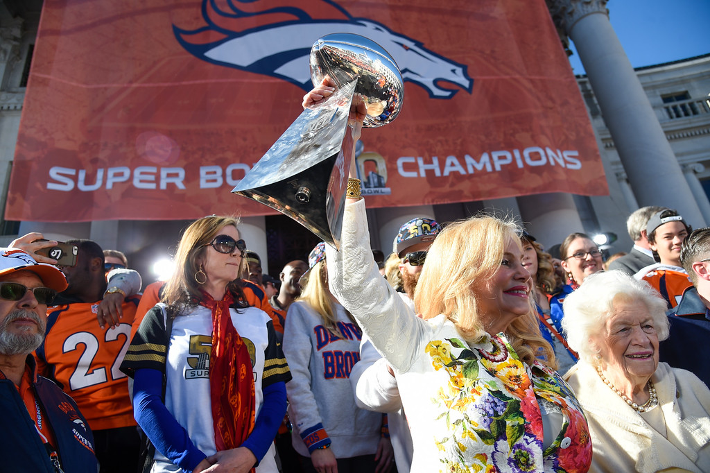 . Annabel Bowlen holds up the Super Bowl Trophy with her mom Joan Spencer, during the celebration. The Denver Broncos celebrated their Super Bowl victory with a  a parade and celebration February 9, 2016 at the City & County Building. (Photo By John Leyba/The Denver Post)