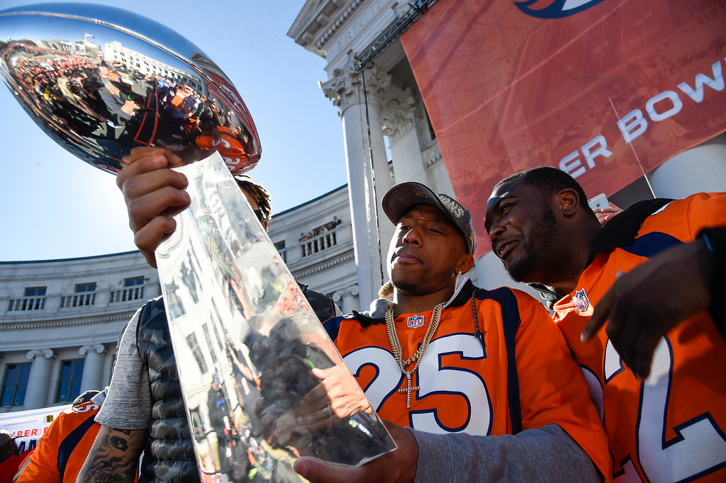 . Denver Broncos Chris Harris Jr. (25) C.J. Anderson (22) smile as they hold the Super Bowl trophy on the stage during the celebration. The Denver Broncos celebrated their Super Bowl victory with a  a parade and celebration February 9, 2016 at the City & County Building. (Photo By John Leyba/The Denver Post)