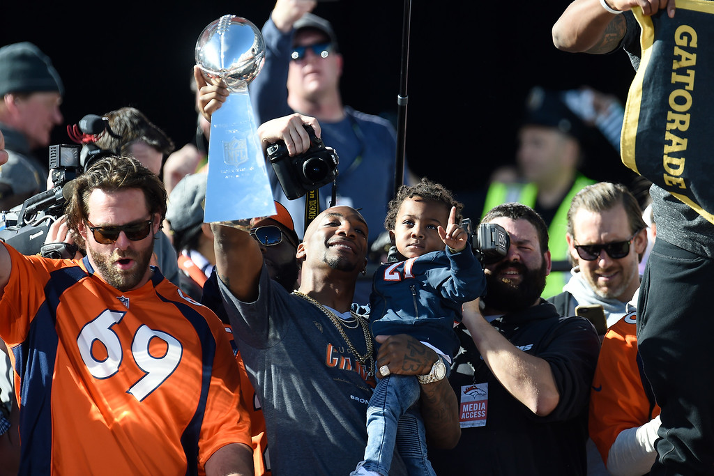 . Aqib Talib hoists the Lombardi Trophy during the Denver Broncos Super Bowl championship celebration and parade on Tuesday February 9, 2016. (Photo By AAron Ontiveroz/The Denver Post)