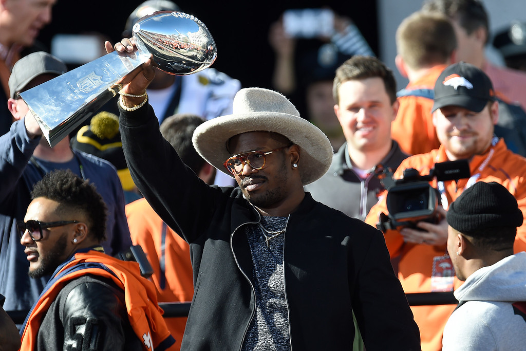 . DENVER, CO. - FEBRUARY 09: Super Bowl MVP Von Miller hoists the Lombardi Trophy on the steps of the City and County Building during the Denver Broncos Super Bowl championship celebration and parade on Tuesday February 9, 2016. (Photo By AAron Ontiveroz/The Denver Post)